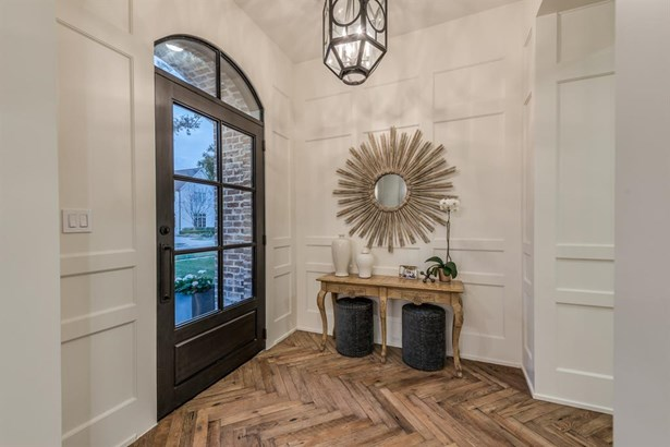 Private entry and entry hall with herringbone pattern oak hardwood flooring. The floors are reclaimed, original face, hand scraped, beveled oak from Pennsylvania, and they continue throughout most of the home. (photo 4)