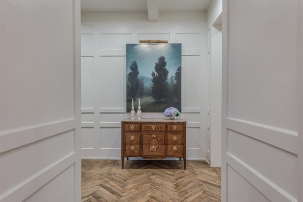 A view of the end of the entry hall from the front door. Wonderful wall panel woodwork details create interesting architectural highlights as you enter the home. (photo 5)