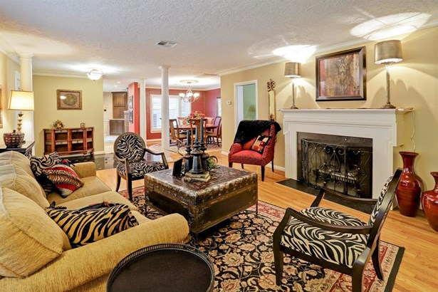 Another view of the formal living room. The floor plan offers an open concept with the formal dining shown in the back. (photo 5)