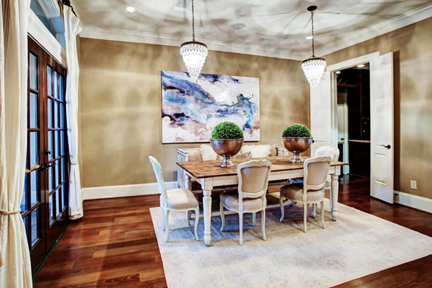 The Formal Dining Room gives an elegant entertaining space and also has double door entry to the large Butlers Pantry and also a gorgeous French door that opens to the front patio. (photo 4)