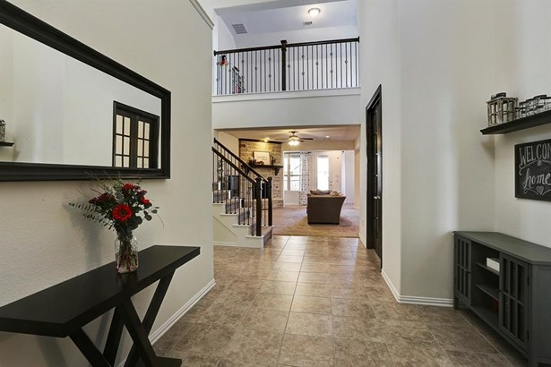 View of the wide open foyer and living room from the entranceway. (photo 3)