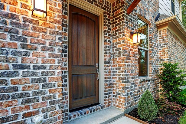 Solid wood entry door with sturdy chrome hardware opens to the first floor living. Front door is flanked with exterior coach lighting. Example photo of completed home- construction not started. (photo 4)