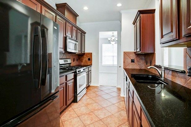 Galley Kitchen with granite and plenty of cabinet space (photo 5)