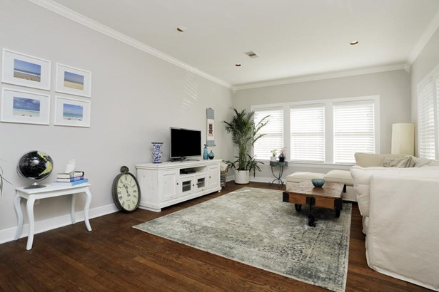 Closer view of the right side of the spacious living space. Windows abound for natural light. (photo 5)