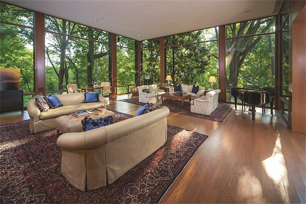 The magnificent living room features spectacular glass walls overlooking lush landscaping, and is the focus of many published articles. (photo 3)