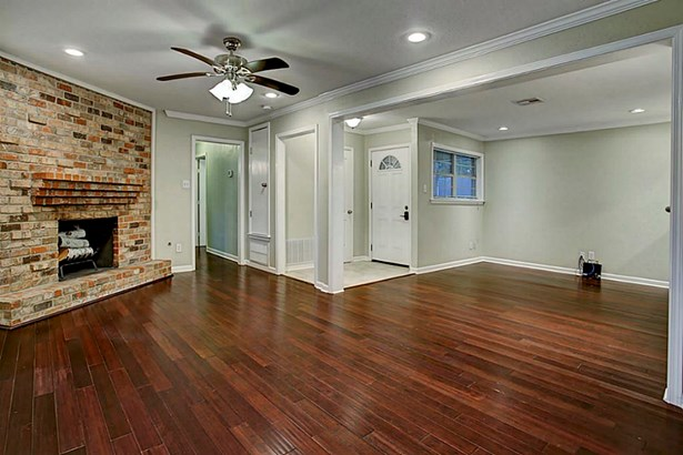 Upon entering you are welcomed by tiled entry that opens to the living and dining space. Home features hardwood floors, crown molding and baseboard detailing. (photo 3)