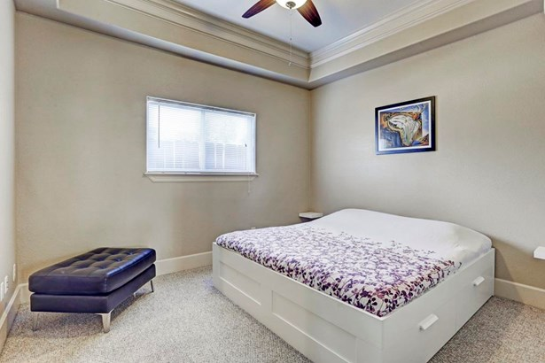 First floor bedroom has carpet, a recessed ceiling and large en-suite bathroom with walk-in closet. (photo 3)