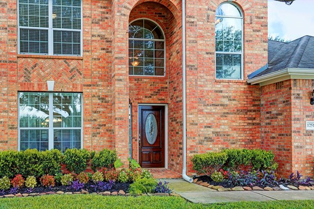 Beautiful brick arched entry with brick paver front stoop and mahogany beveled and glass front door. (photo 2)