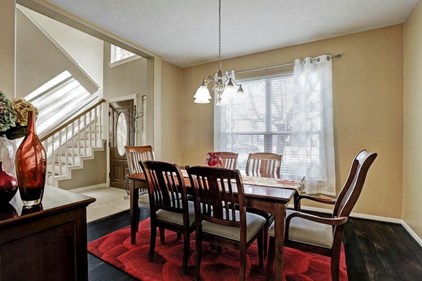 Another view of formation dining room off entry and adjacent to kitchen. This large light filled room could easily convert to a private study with French Doors. (photo 5)
