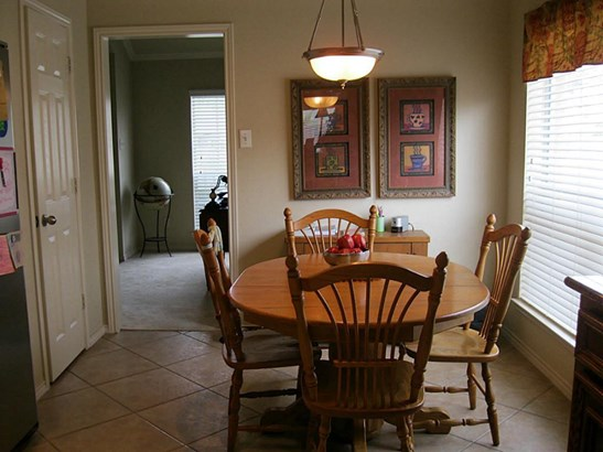 Eating area of breakfast room with large window for light. (photo 2)