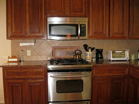 Kitchen features gas range with microwave (photo 3)