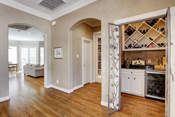 Upon entering the home you ll find the wine grotto offering bottle storage and refrigerator. (photo 2)