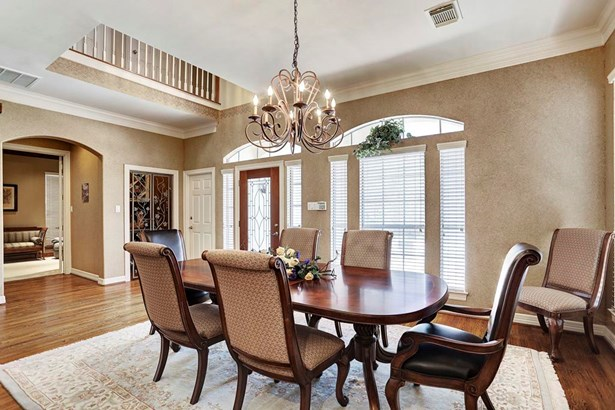 The large 13x21 SF formal dining room has hard wood flooring and chandelier lighting. (photo 3)