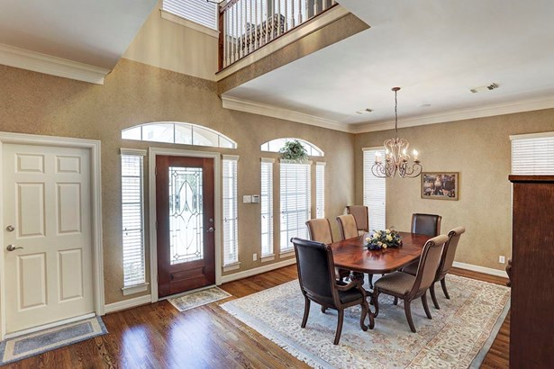 The front door is decorated with leaded glass. The transom windows offer ample natural light. (photo 4)