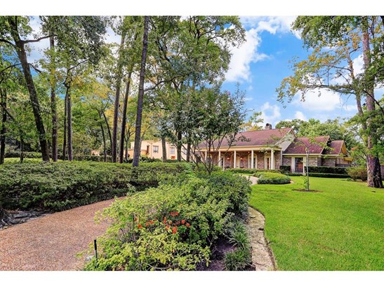 A circular drive through tall trees, flanked by azaleas, leads right up to the charming front porch (photo 1)