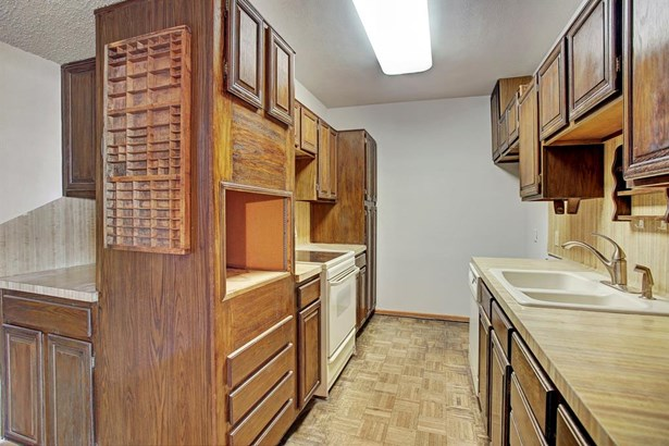 The kitchen is mostly in original condition. Opportunities abound for re-configuring and opening up this space. (photo 4)