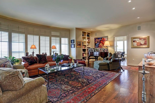 Large living room boasts tons of natural light. All windows complete with plantation shutters. (photo 2)