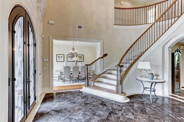 2 story Entry with marble floors, grand staircase, and double doors! (photo 2)