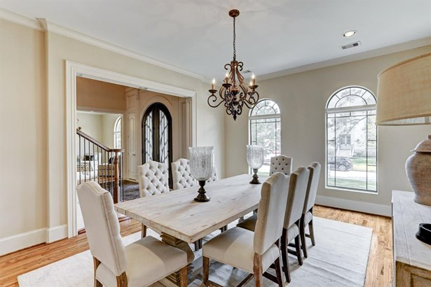 Formal Dining Room is a great oversized place for large furniture and ideal for entertaining! Hardwood floors, crown molding, large window, and easy access to the Kitchen are a few of the features. (photo 3)