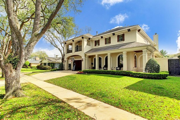 This home is stunning and the tree lined street adds even more curb appeal to this home. (photo 2)