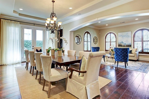The oversized dining room is fantastic for entertaining. The room flows into the formal living room, the wine room, and the beautiful patio garden with a lovely fountain. (photo 5)