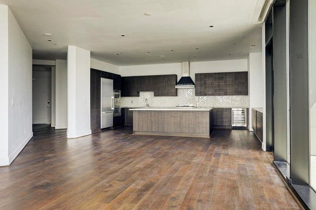 The kitchen features a large island, top of the line stainless steel Bertazzoni appliances and wine cooler. (photo 4)