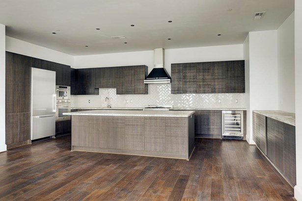 This residence features engineered hardwood floors and Italian Bertazzoni stainless steel appliances. (photo 5)