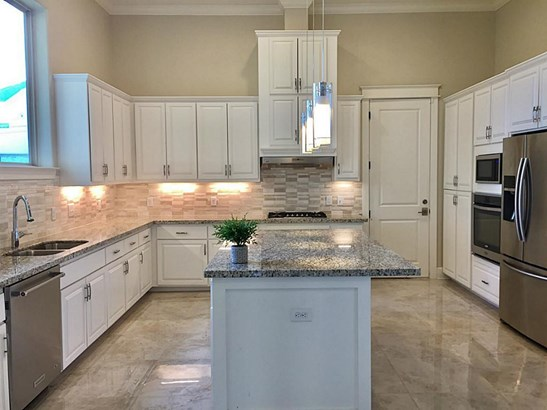 This beautiful kitchen features stainless steel appliances, tons of built in cabinets for storage, a gas range, and granite countertops! Not pictured is a walk-in pantry! Storage is a plenty throughout the home! (photo 5)