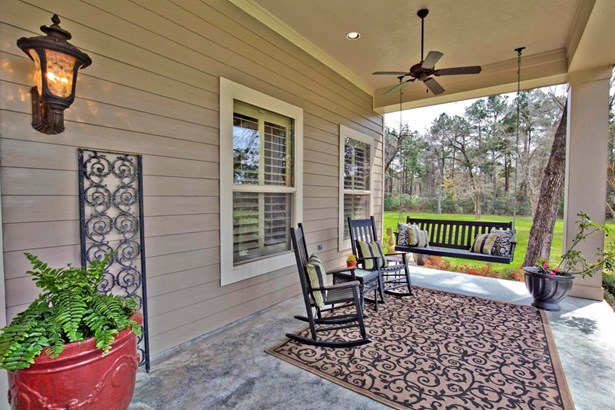 Wonderful front porch with sitting area overlooking the landscaped grounds. Imagine sitting here at the end of the day. (photo 4)