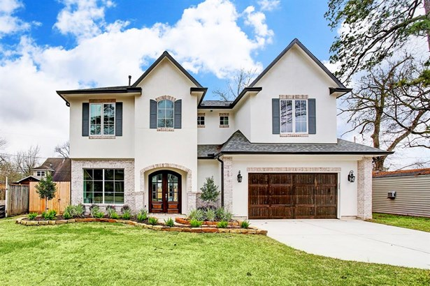 Photo is of previously completed home with the same floor plan. Completion scheduled for 10/1/18. 1541 Gardenia is located on one of the most sought after blocks in oak Forest. Home will offer a stucco and brick facade with wooden garage door complimentin (photo 1)