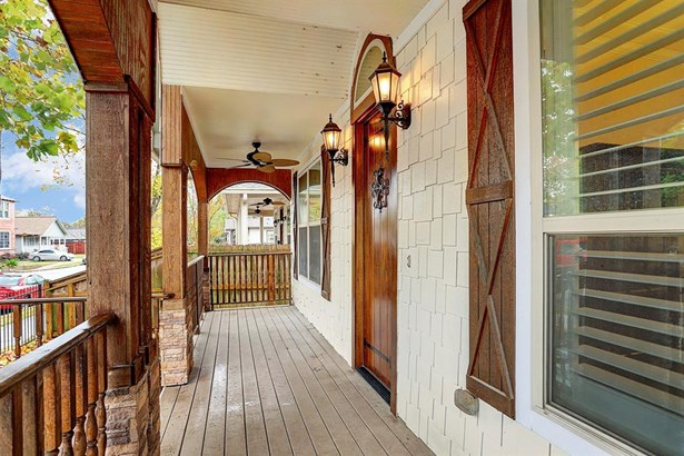 Red brick steps lead to the huge front porch, perfect for patio furniture to enjoy your morning and evenings. Wood porch railing and beams compliment the solid refinished wood door and wood shutters flanking the windows. The two ceiling fans allow a cool (photo 3)