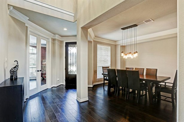 Another view of the formal dining room facing the front door and the study/formal living room to the left. Notice the wrought iron detail & privacy glass on the front door. (photo 5)