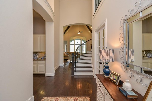 To the right of the entry are French doors to your study, straight ahead is your family room and to the left is your butlers pantry then dining room. (photo 5)