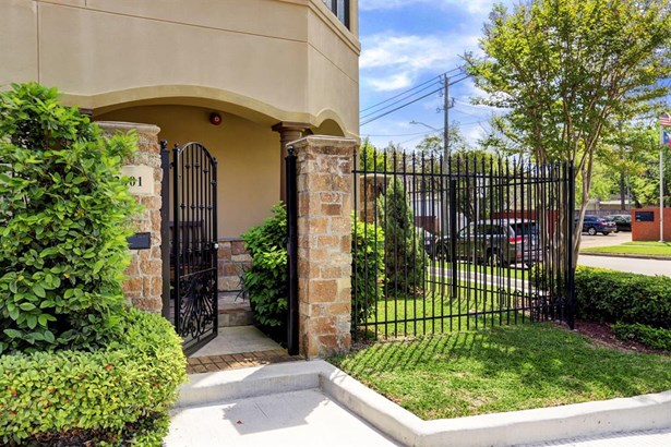 Private patio wrought iron gate leading to the front door (photo 2)