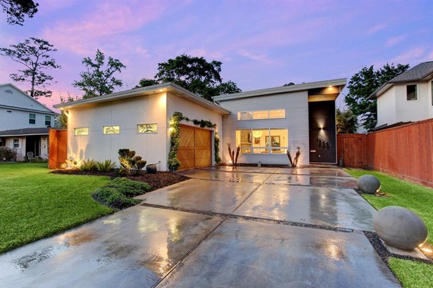 Stunning contemporary home equipped with the upmost attention to detail. Concrete driveway accented by crushed granite and concrete spheres lit with accent uplighting set the tone for this modern residence. (photo 1)