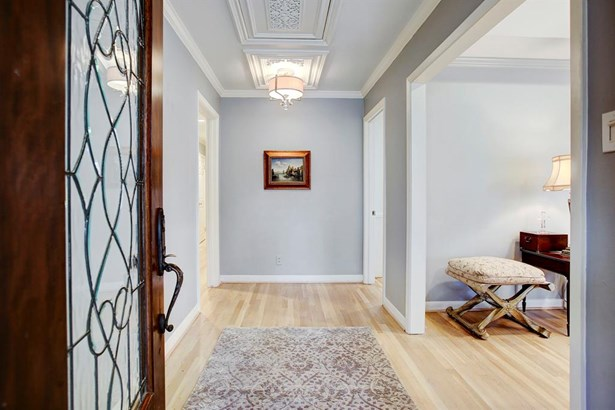 The Entry sets the tone for this beautiful home with fresh paint on the walls and millwork, and intricate architectural detail not often seen. The white oak hardwood floors have been refinished and whitewashed. (photo 3)