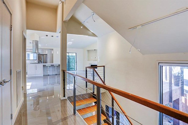Wooden plank stairs with cable railing leads up to second floor living area (photo 4)