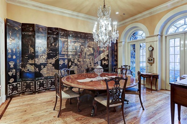 The formal dining room features oak hardwood floors, crown molding and custom millwork. There is a space for potential temperature controlled wine storage. (photo 4)