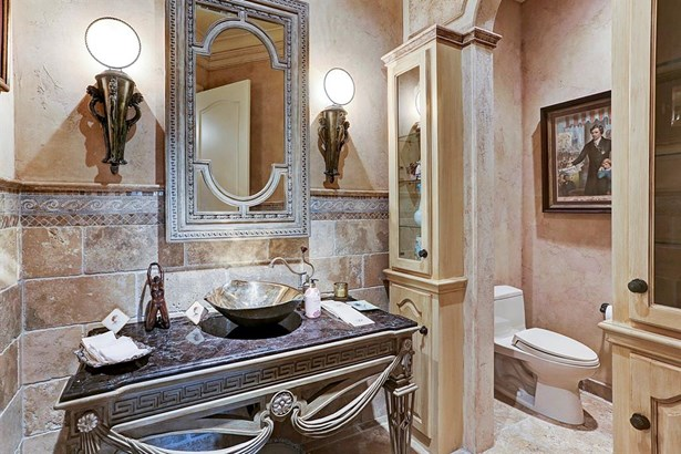 """The powder bath feature beautiful mosaic and stone wainscoting and an artful """"venezia"""" medallion in the floor. (photo 5)"""