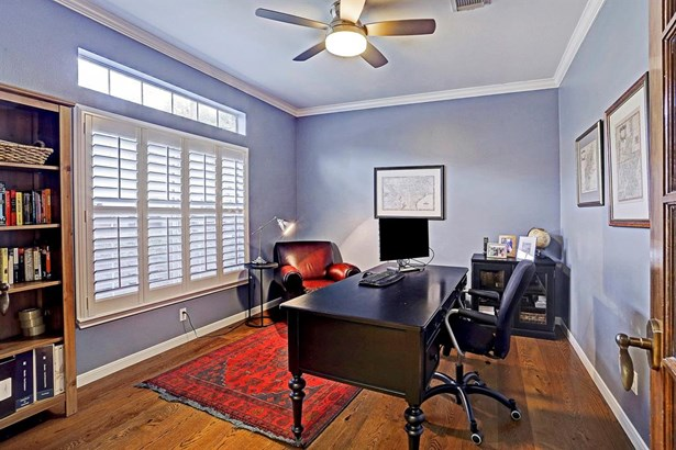 Get all of your work done in this study that has great views of the front yard. (photo 4)