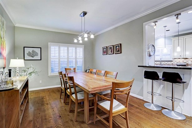 Entertain all of your guests in this formal dining room that opens to the kitchen! (photo 5)