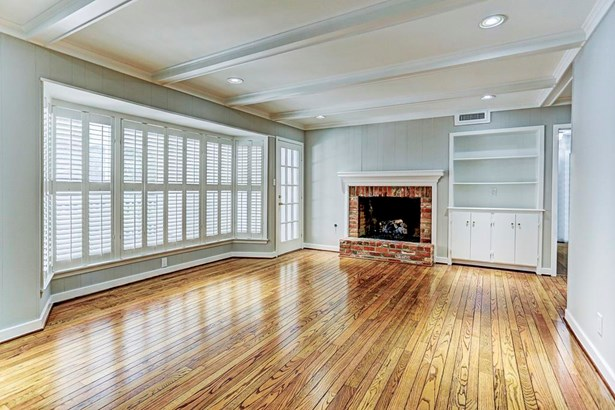 Living Room has built-ins & Wood Burning Fireplace (photo 3)