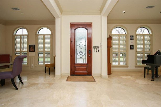 Gas lanterns, travertine stairs and wrought iron hand rails. Beautiful mahogany door with muted glass and decorative wrought iron, combination door entrance. (photo 3)