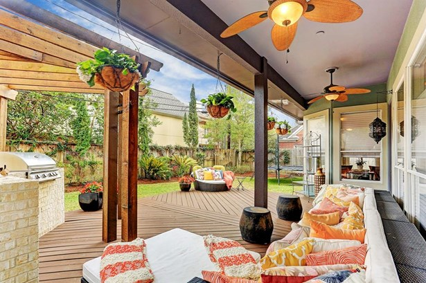 Incredible backyard! Come sit under this relaxing covered porch or in the sun if you prefer a tan. large deck, built-in summer kitchen with pretty loggia and room for a pool. (photo 1)