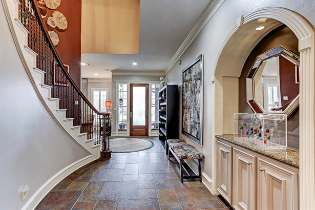 Grand entry at glass front door opens to sweeping staircase and formal living room. (photo 3)