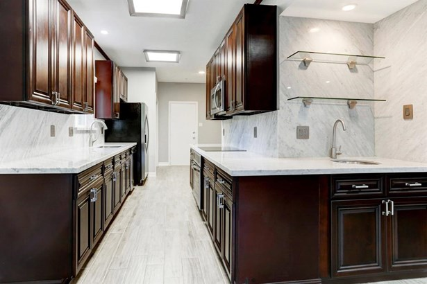 Upon entering the front door as shown toward the right of this photo, you know that you are in from something special! Take in the freshness and serenity of the pale gray interior coloring. Below are gray washed tile flooring which look exactly as hardwoo (photo 4)