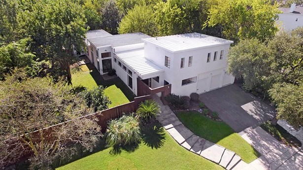 [Aerial View/ Front Elevation]Form follows function in this Modern home custom-built for the seller by Covington Builders. Positioned at street s end in a park-like setting on an elevated lot. (photo 1)