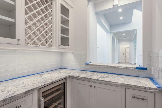 Wet bar located off the entry and adjacent to the kitchen convenient for entertaining. (photo 5)