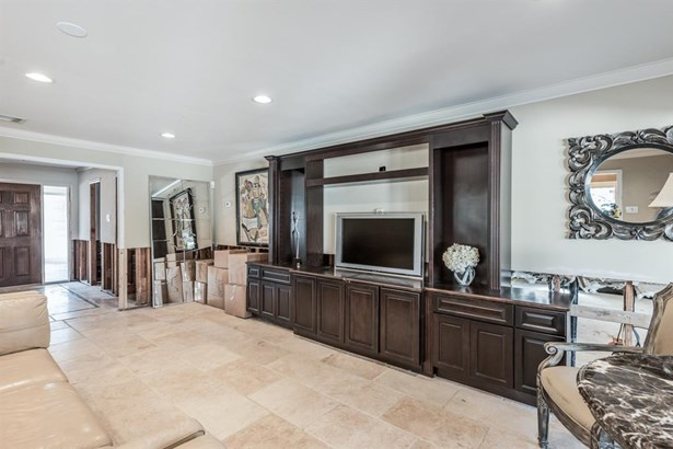 Entertaining is easy with the furniture-quality, built-in entertainment center by Thomasville, complete with glass shelving and valuable lower cabinet storage. (photo 4)