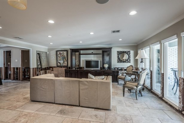Alternate view of the family room from the kitchen. Wide open spaces and abundant natural light provide great open spaces for center-of-the-home activities. (photo 5)